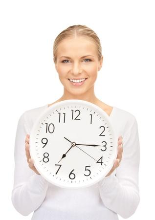 woman clock: Foto de mujer sosteniendo el gran reloj sobre blanco  Foto de archivo