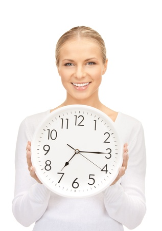 Picture of Woman holding-big Clock over white Standard-Bild