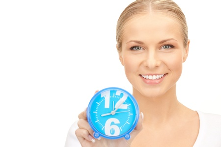 picture of woman holding alarm clock over white photo