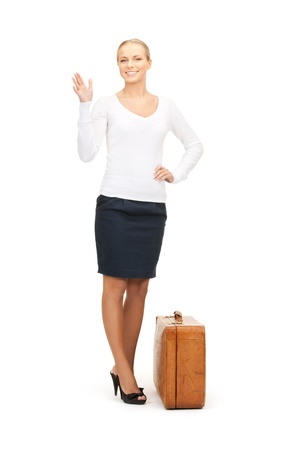picture of beautiful woman with brown suitcase photo