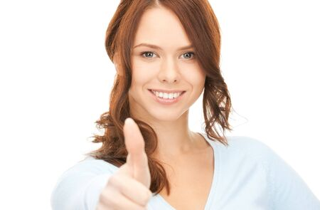 bright picture of lovely teenage girl with thumbs up Stock Photo - 8325088