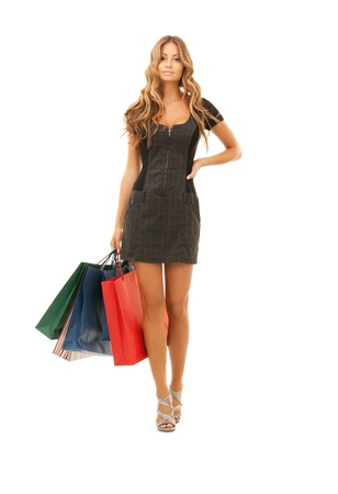 fashionable girl: lovely woman with shopping bags over white