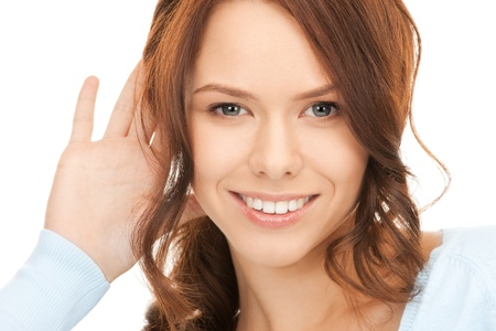 bright picture of young woman listening gossip Stock Photo - 8329002