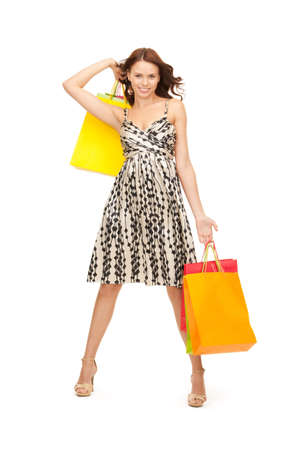 lovely woman with shopping bags over white Stock Photo - 8325049