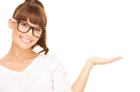 spec: beautiful woman showing something on the palm of her hand Stock Photo