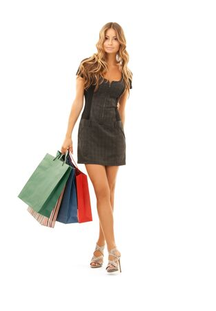 lovely woman with shopping bags over white Stock Photo - 8334915