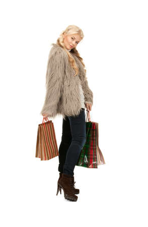 lovely woman with shopping bags over white Stock Photo - 8334919