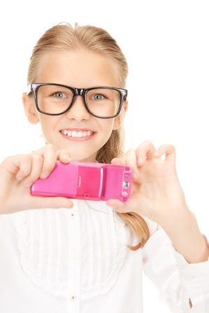 taking video: portrait of happy girl taking picture with cell phone