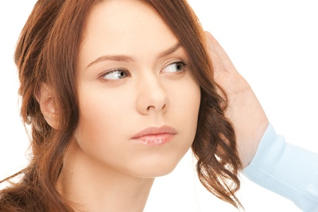 bright picture of young woman listening gossip Stock Photo - 8334971