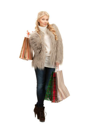 lovely woman with shopping bags over white Stock Photo - 8335220