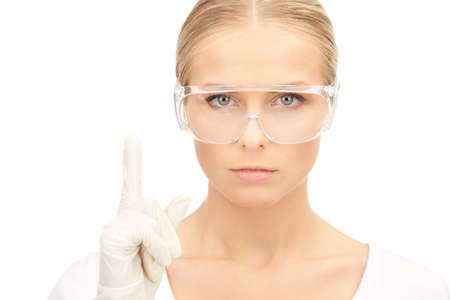 bright picture of woman in protective glasses and gloves photo