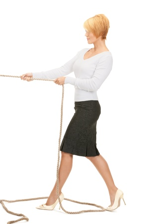 bright picture of business woman pulling rope