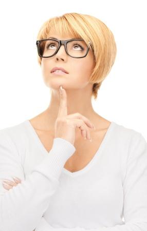 bright picture of pensive businesswoman over white  photo
