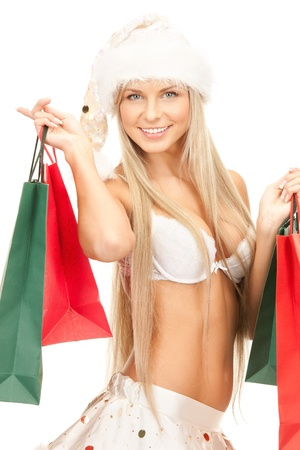 picture of cheerful santa helper with shopping bags photo