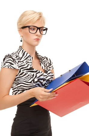 picture of a young attractive businesswoman with folders photo