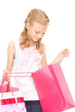 happy girl with shopping bags over white photo