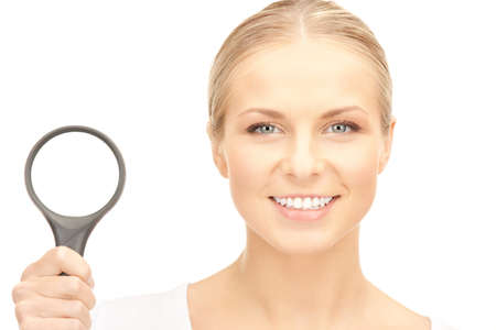 picture of woman with magnifying glass over white Stock Photo - 8401905