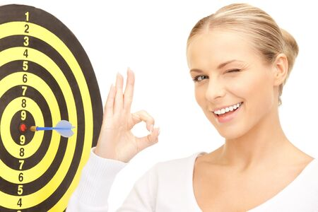 bright picture of businesswoman with dart and target photo
