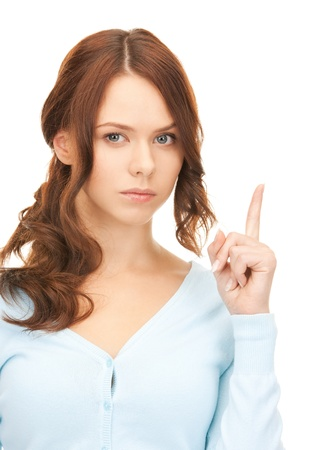 picture of attractive young woman with her finger up Stock Photo - 8401961
