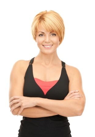 BUEN VIVIR: imagen brillante de instructor de fitness encantadora sobre blanco