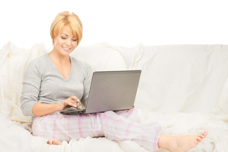 bright picture of happy woman with laptop computer Stock Photo - 8401897