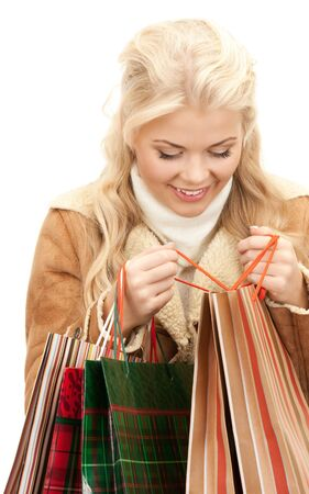 lovely woman with shopping bags over white Stock Photo - 8410601