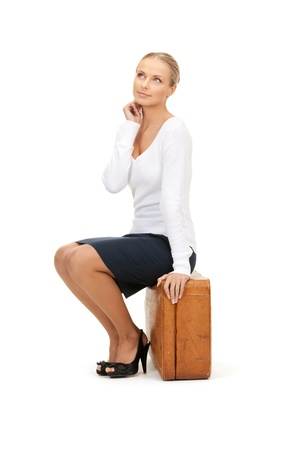 picture of beautiful woman with brown suitcase Stock Photo - 8410417