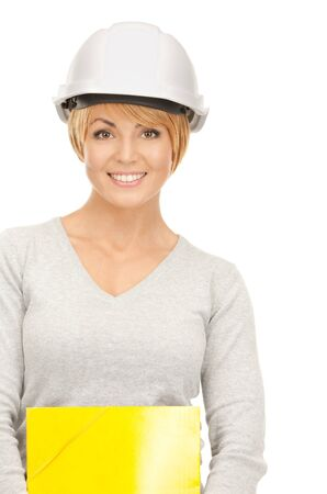 bright picture of female contractor in helmet over white Stock Photo - 8410587