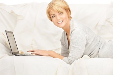 bright picture of happy woman with laptop computer  photo