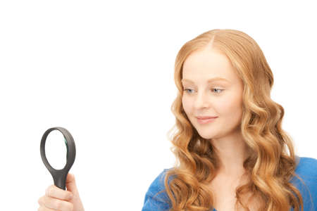 picture of woman with magnifying glass over white Stock Photo - 8410757