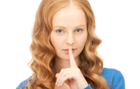 bright picture of young woman with finger on lips Stock Photo - 8410937
