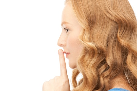 bright picture of young woman with finger on lips Stock Photo - 8410935
