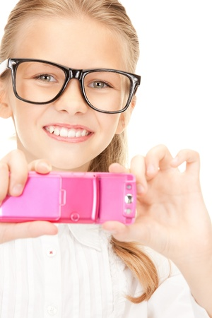 portrait of happy girl taking picture with cell phone photo