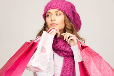 lovely woman with shopping bags over grey Stock Photo - 8441205