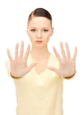 bright picture of young woman making stop gesture Stock Photo - 8441126
