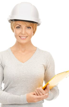 bright picture of female contractor in helmet over white