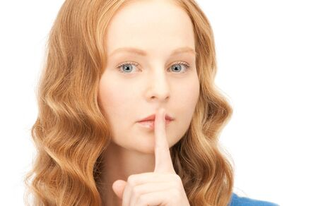 bright picture of young woman with finger on lips Stock Photo - 8454004
