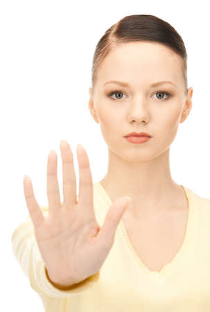 bright picture of young woman making stop gesture Stock Photo - 8453993