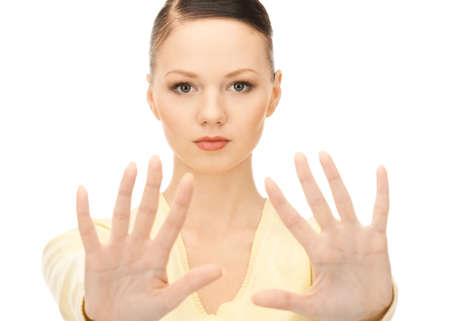 bright picture of young woman making stop gesture Stock Photo - 8457306
