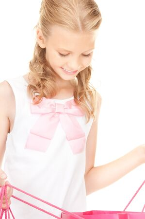 happy girl with shopping bags over white Stock Photo - 8548609
