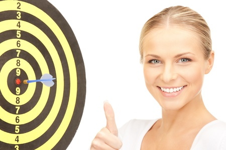 bright picture of businesswoman with dart and target Stock Photo - 8548611