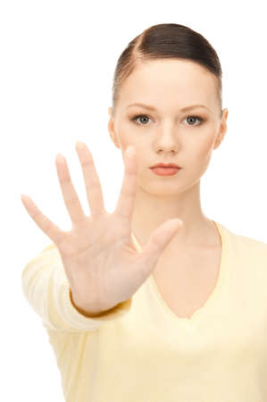bright picture of young woman making stop gesture Stock Photo - 8548615