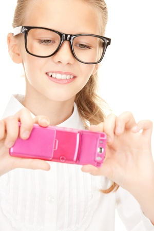 portrait of happy girl taking picture with cell phone Stock Photo - 16573563