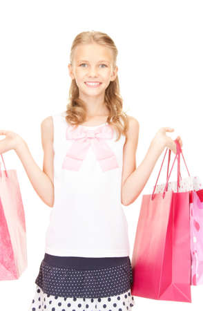 happy girl with shopping bags over white Stock Photo - 16573564