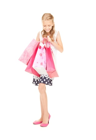 happy girl with shopping bags over white Stock Photo - 16573562