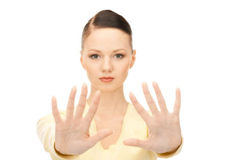 bright picture of young woman making stop gesture Stock Photo - 8504020