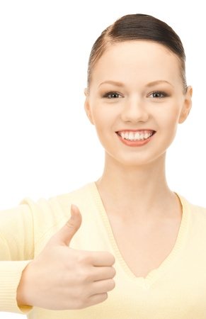 bright picture of lovely teenage girl with thumbs up Stock Photo - 16573570