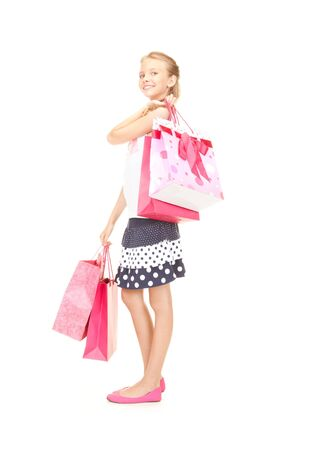 happy girl with shopping bags over white Stock Photo - 16573567