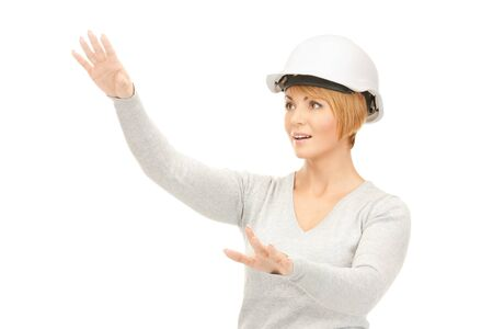 picture of female contractor in helmet working with something imaginary  photo
