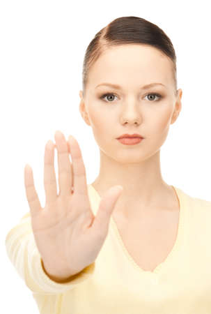 bright picture of young woman making stop gesture Stock Photo - 8740253